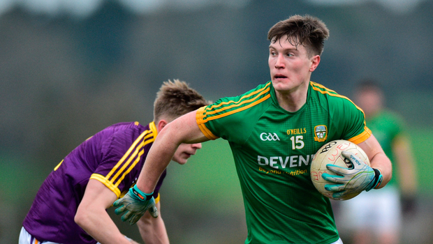 Meath's Thomas O'Reilly gets away from Martin O'Connor of Wexford. Photo: Matt Browne