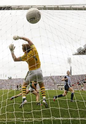 Paul Mannion fists the ball past Brendan Kealy for Dublin's first goal