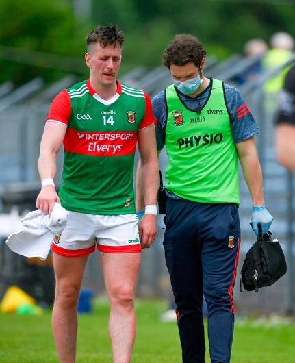 Cillian O'Connor of Mayo leaves the pitch with an injury during the Division 2 semi-final between Clare and Mayo. Photo: Brendan Moran/Sportsfile