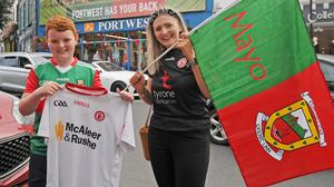 Crossing the divide: Tyrone fan Niamh Campbell in Westport with Mayo fan Ruán O'Reilly. Credit: Conor McKeown
