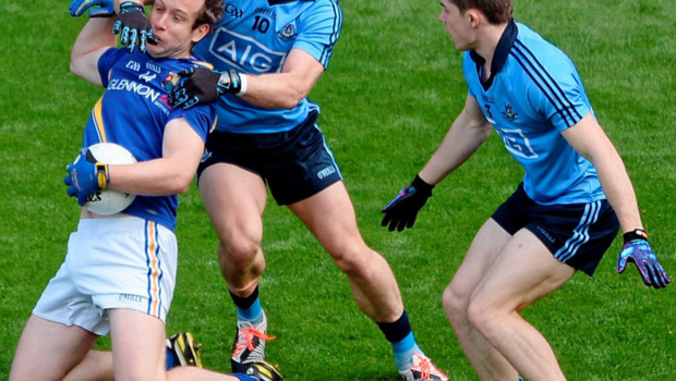 Much like Dublin and the rest of Leinster, Paul Flynn and David Byrne make life difficult for Longford's Brian Kavanagh