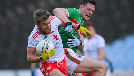 Michael O'Neill of Tyrone in action against Matthew Ruane of Mayo