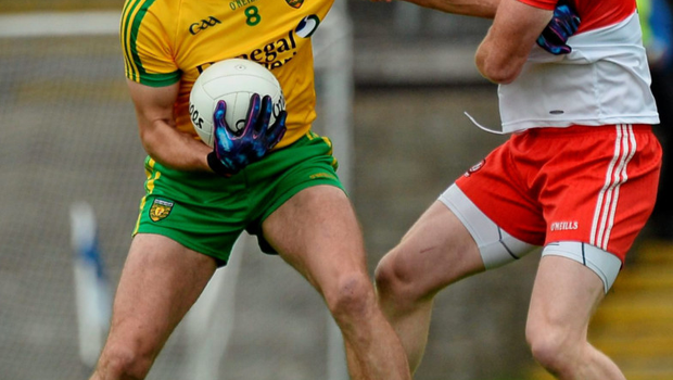 Donegal's Neil Gallagher under close attention from Derry's Fergal Doherty during last night's Ulster championship semi-final Photo: Oliver McVeigh