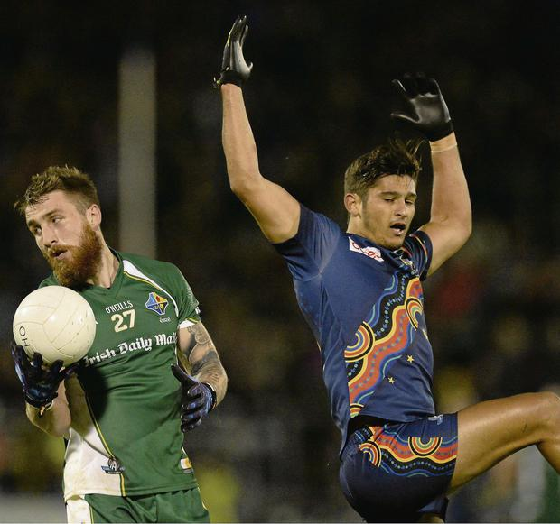 Zach Tuohy catches the ball ahead of Sharrod Wellingham during Ireland's comfortable first Test victory in Cavan