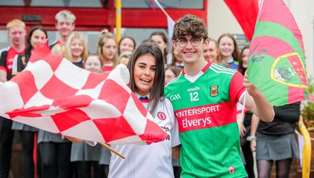 Róise McElholm and Conor Grimley show their colours at Sacred Heart College in Omagh, Co Tyrone. Photo: Gerry Mooney