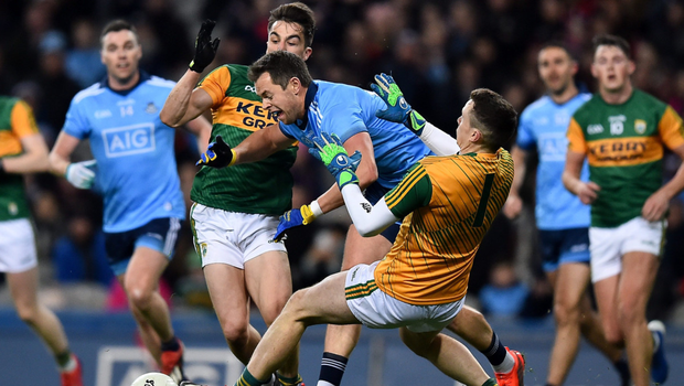 Dublin's Dean Rock is fouled by Kerry's Brian Ó Beaglaoich, left, and Shane Ryan, resulting in a penalty on Saturday night. Photo: Sportsfile
