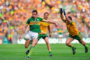 David Moran, Kerry, in action against Paddy McGrath, right, Donegal