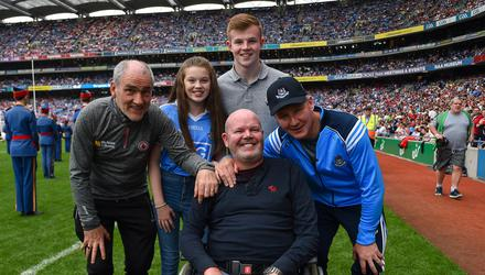 Anto Finnegan with Jim Gavin (right) and Mickey Harte (left). Image credit: Sportsfile.