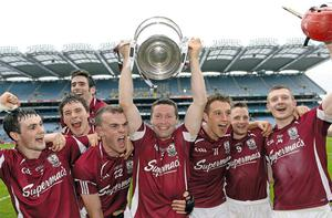 Galway players (l-r): Johnny Coen, Conor Cooney, Jonathan Glynn, Damien Hayes, Niall Burke, Andy Smith and Joe Canning celebrate with the Bob O'Keeffe Cup after winning the Leinster hurling title for the first time in 2012