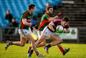 Damien Comer, NUI Galway in action against Stephen Coen and Chris Barrett, Mayo