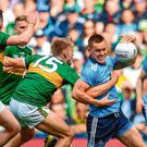 Con O'Callaghan of Dublin is tackled by Killian Spillane of Kerry