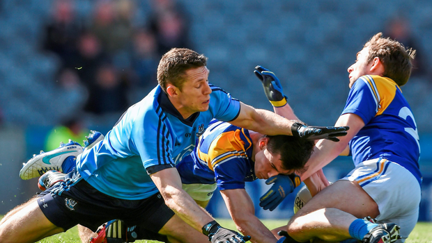 Ross McInerney and Pauric Gill, right, Longford, in action against Dublin's Darren Daly