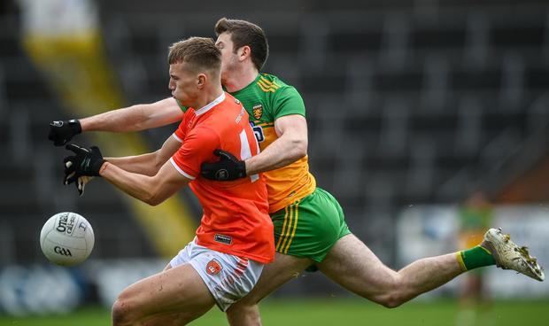 Rian O'Neill of Armagh in action against Eoghan Bán Gallagher of Donegal. Photo by David Fitzgerald/Sportsfile