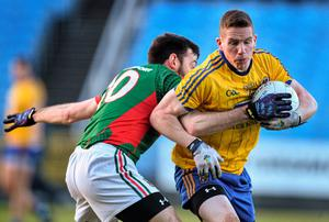 Sean McDermott, Roscommon, in action against Kevin McLoughlin, Mayo