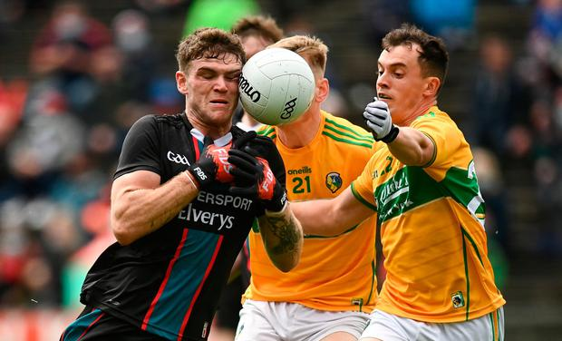 Mayo's Jordan Flynn in action against Leitrim's Aaron Hoare, left, and James Mitchell during Sunday's Connacht SFC semi-final match at Elverys MacHale Park, Castlebar. Photo: Harry Murphy/Sportsfile
