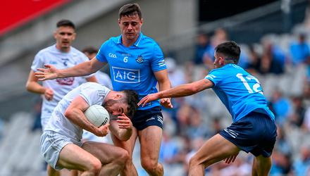 Kevin Flynn of Kildare in action against Brian Howard and Niall Scully of Dublin