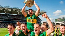 Kerry's Liam Kearney lifts the Tom Markham cup as his team-mates celebrate. Electric Ireland GAA Football All Ireland Minor Championship Final, Kerry v Donegal. Croke Park, Dublin