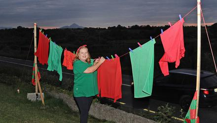 Vivian Murray's clothes line, outside her home in Castlebar, Co Mayo, is adorned in the county's colours. Photo: Conor McKeown