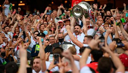 Tyrone captain Pádraig Hampsey lifts the Sam Maguire Cup following Saturday's All-Ireland final. Photo: Stephen McCarthy/Sportsfile