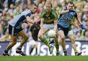 Colm Cooper in action against Dublin duo Johnny Cooper and Jack McCaffrey in what was a masterclass from the Kerry star