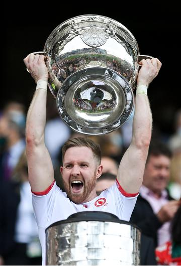 Frank Burns of Tyrone lifts the Sam Maguire Cup
