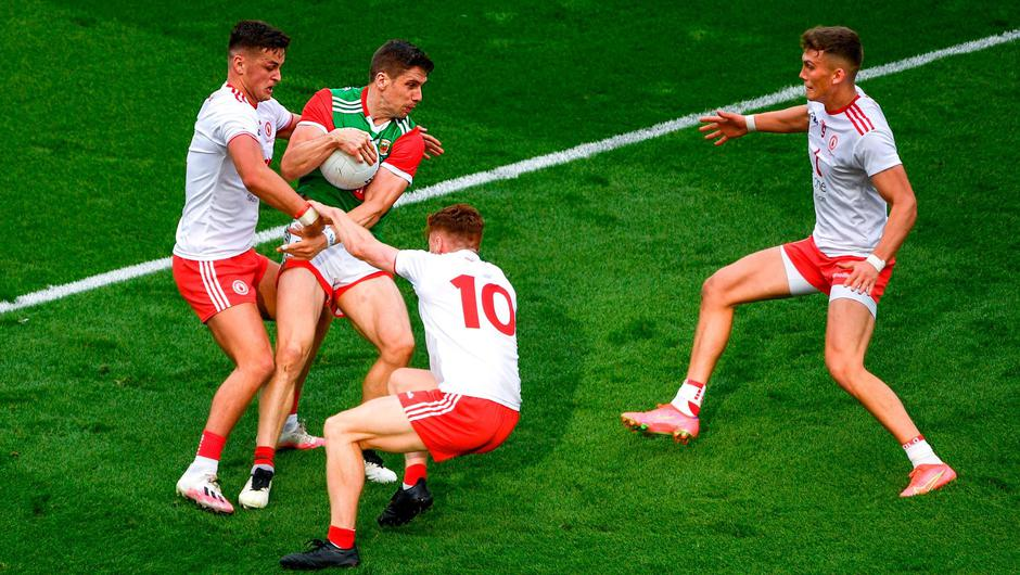 Mayo's Lee Keegan is surrounded by Tyrone's Michael McKernan, Conor Meyler, and Conn Kilpatrick during Saturday's All-Ireland SFC final at Croke Park. Photo: Daire Brennan/Sportsfile
