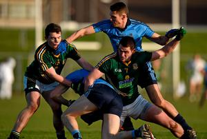 Denis Bastic, supported by Darren Daly, Dublin, is tackled by Meath players Bryan Menton, 7, and Joey Wallace