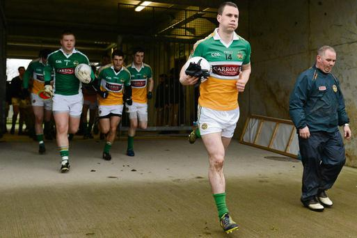 Niall McNamee, leading out the Offaly team for an O'Byrne Cup game, says he has put his problems behind him and is now enjoying the game more than ever