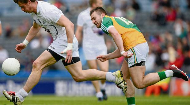 Emmet Bolton gets away from Offaly's Ken Casey to set up a Kildare attack