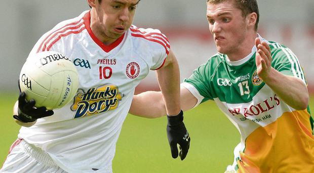 Offaly's Daithi Brady chases Matthew Donnelly of Tyrone