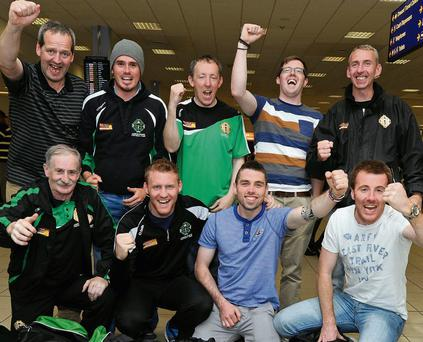 Members of the winning London team and their backroom staff arrive in Luton Airport following their win over Leitrim