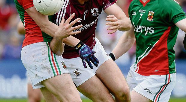 Paul Conroy, Galway, in action against Lee Keegan, left, and Colm Boyle, Mayo in the Connacht championship in May