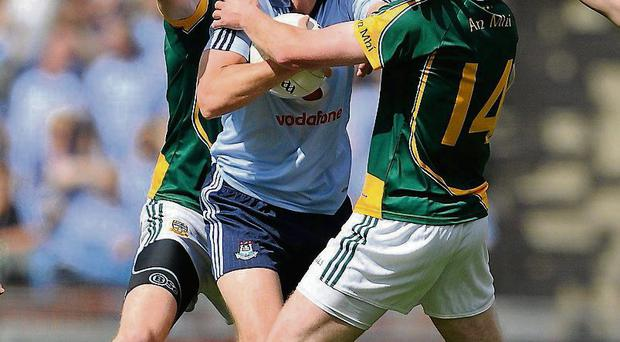 Barry Cahill tries to get past Meath duo Mark Ward and Shane O'Rourke during Dublin's game with Meath in 2010
