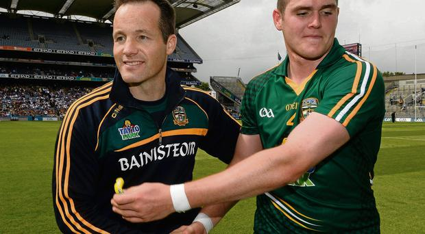 Meath manager Mick O'Dowd congratulates Bryan Menton after the team's victory against Wexford which set up tomorrow's showdown against Dublin