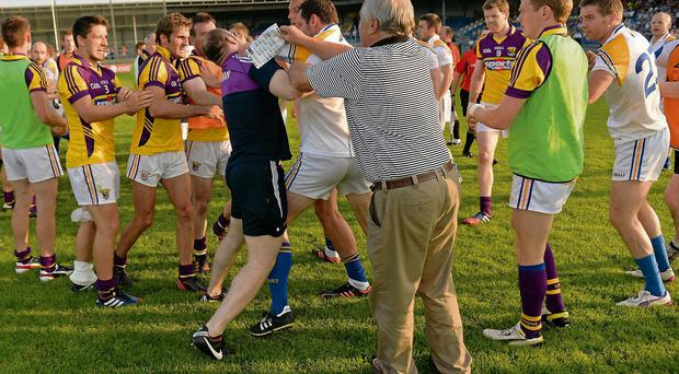 Temperatures rise at the end of normal time in the clash between Longford and Wexford