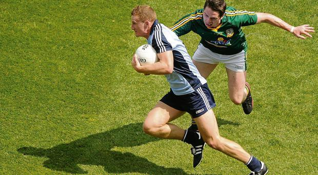 Ciaran Kilkenny gets away from Peader Byrne of Meath during a man-of-the-match display