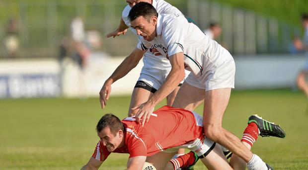 Louth's Dessie Finnegan under pressure from Kildare duo Mikey Conway and John Doyle