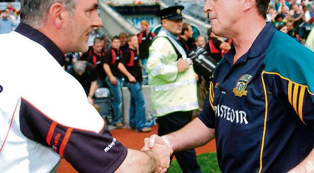 Colm Coyle shakes hands with Tyrone manager Mickey Harte after Meath's win in the 2007 All-Ireland quarter-final.