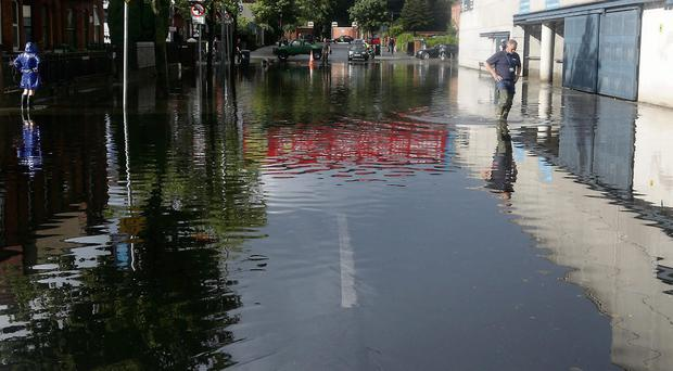 The metaphorical floodgates are expected to open in Croke Park today when Cavan play London in the first of a qualifiers triple-header. Yesterday, as our pictures show, there was plenty of rain to contend with outside the ground. However, officials are sure that the pitch will be fit for today's six-hour football bonanza