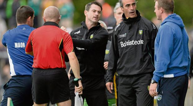 Jim McGuinness and Justin McNulty exchange words