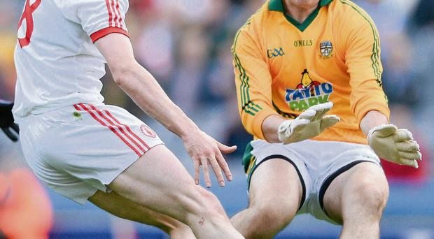 Tyrone's Colm Cavanagh has a shot on goal stopped by Meath goalkeeper Paddy O'Rourke during their exciting qualifier encounter in Croke Park on Saturday