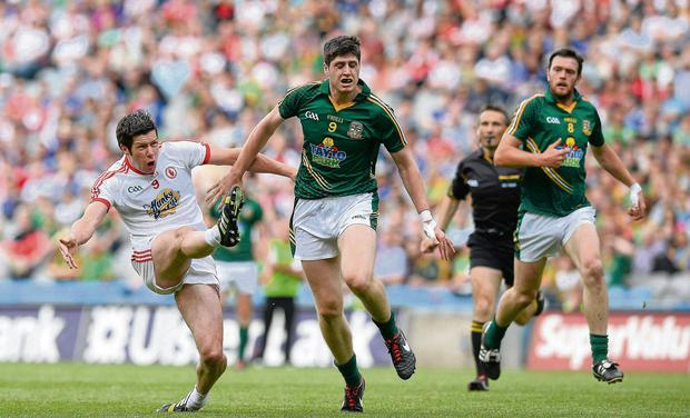 Sean Cavanagh gets a shot away despite the efforts of Meath's Conor Gillespie