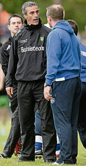 Donegal manager Jim McGuinness exchanges words with Laois counterpart Justin McNulty at the Donegal Laois game last weekend