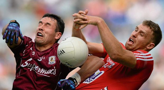 Galway's Finian Hanley battles for posession with Ciaran Sheehan of Cork during their All-Ireland SFC qualifier clash in Croke Park