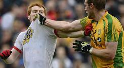 Neil McGee, Donegal, and Peter Harte, Tyrone, test the strength the strength of each others jerseys