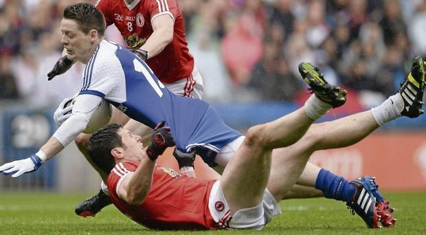 Conor McManus, Monaghan, is tackled by Sean Cavanagh, Tyrone