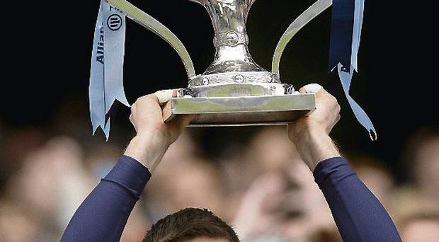 Stephen Cluxton lifts the trophy after Dublin's victory over Tyrone in this year's Allianz League final