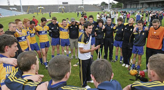 Young guns: Clare trainer Paul Kinnerk speaks to his players after the 2010 Munster minor championship semi-final game against Limerick