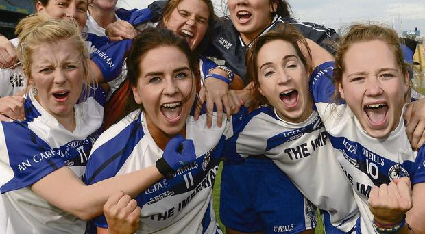 Cavan players celebrate their side's victory over Tipperary in the TG4 All-Ireland Ladies IFC final