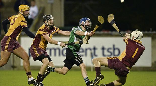 Paddy Ward blasts the ball past Craobh Chiarain goalkeeper Stephen Chester to score a goal for Lucan Sarsfields